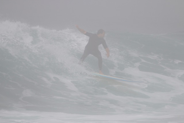 Todd Gailey on a set wave in the fog